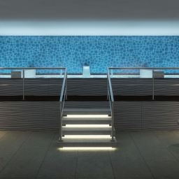 Elevated hydrotherapy area designed to fit within the constraints of two floors of a building